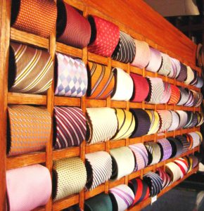 Retailers specializing in men's tailored clothing continue to sell ties to their clientele, despite the fact that the argument about ties rages on.