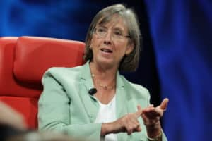 Looking at Mary Meeker, I see that this mint green jacket does not serve to give her an authoritative look. This is important, because if you look at her body language and her posture, she appears to be making an authoritative point. The problems with the jacket are the color and that it is ill-fitting. Also of note are her glasses. They seem to age her. Who wants that?