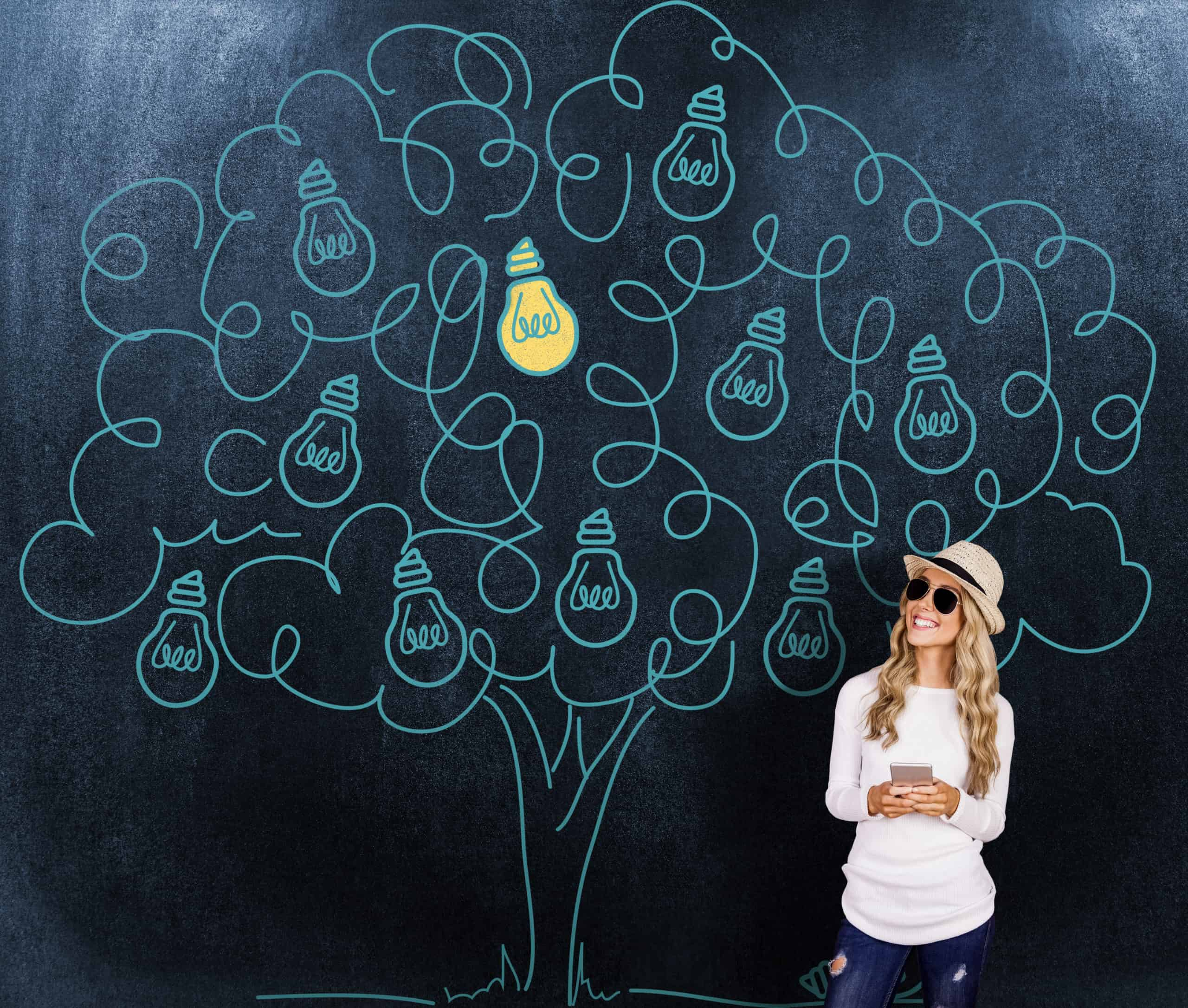 woman in straw hat and sunglasses in front of a blue tree graphic with lightbulbs